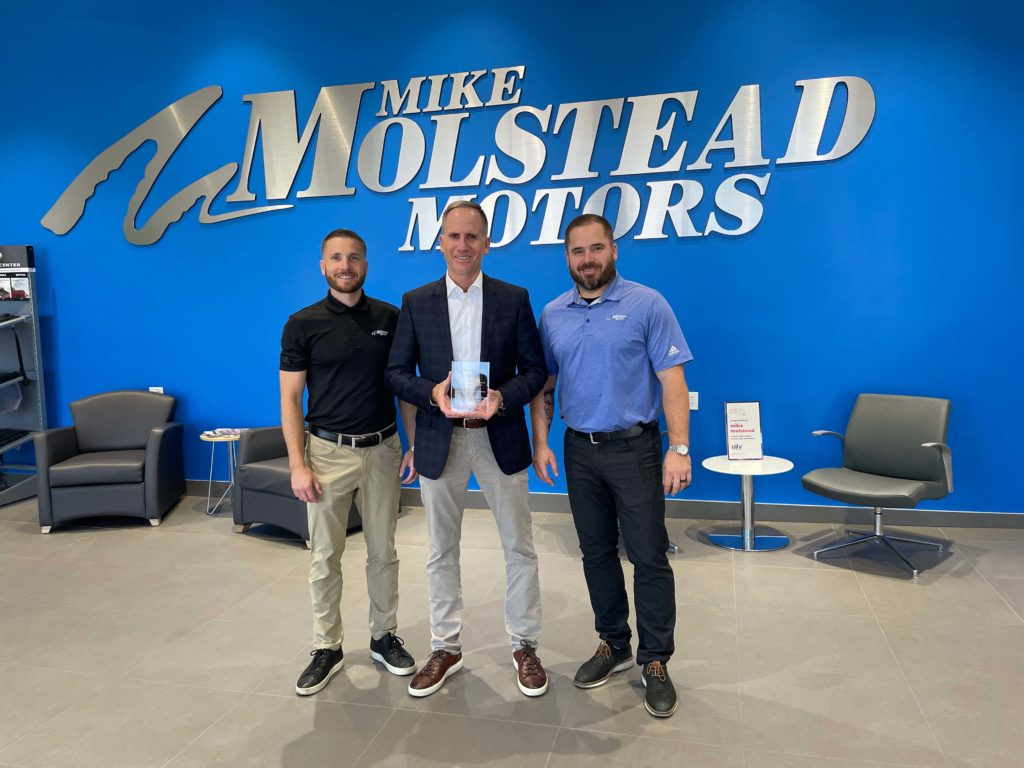 Josh, Mike, and Jordan Molstead celebrate the dealership's 25th anniversary